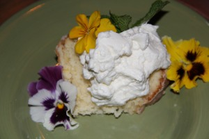 Lemon Cake with Whipped Cream and Edible Spring Flowers